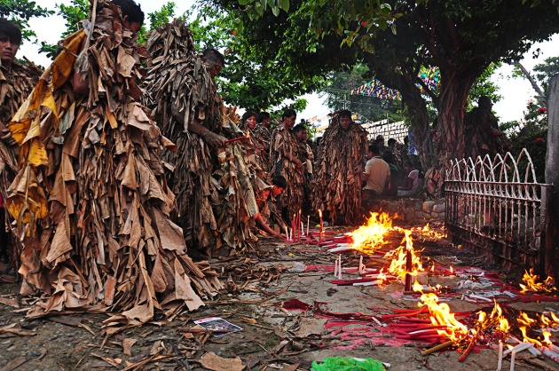 Devotees burn candles as offering to St John the Baptist.