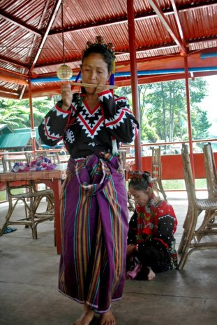 "This T'boli woman plays the ""kubing"", a mouth harp made of bamboo commonly used by indigenous tribes in Mindanao."